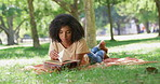 The park is the perfect place to explore her love for books